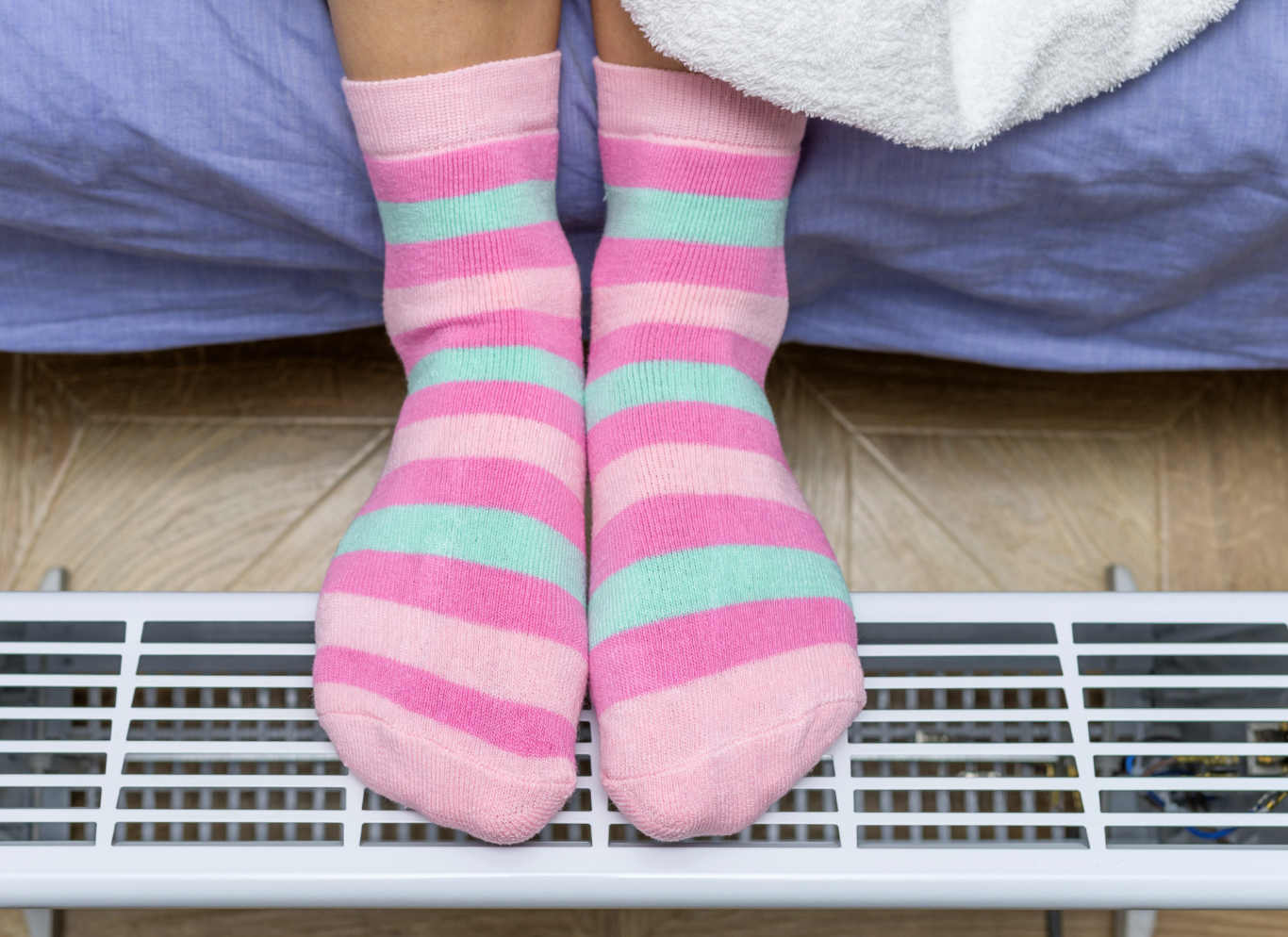 Why wear wet socks to bed?
